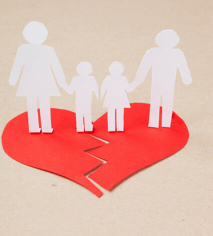 Divorce effect on kids concept with hands cutting paper people family